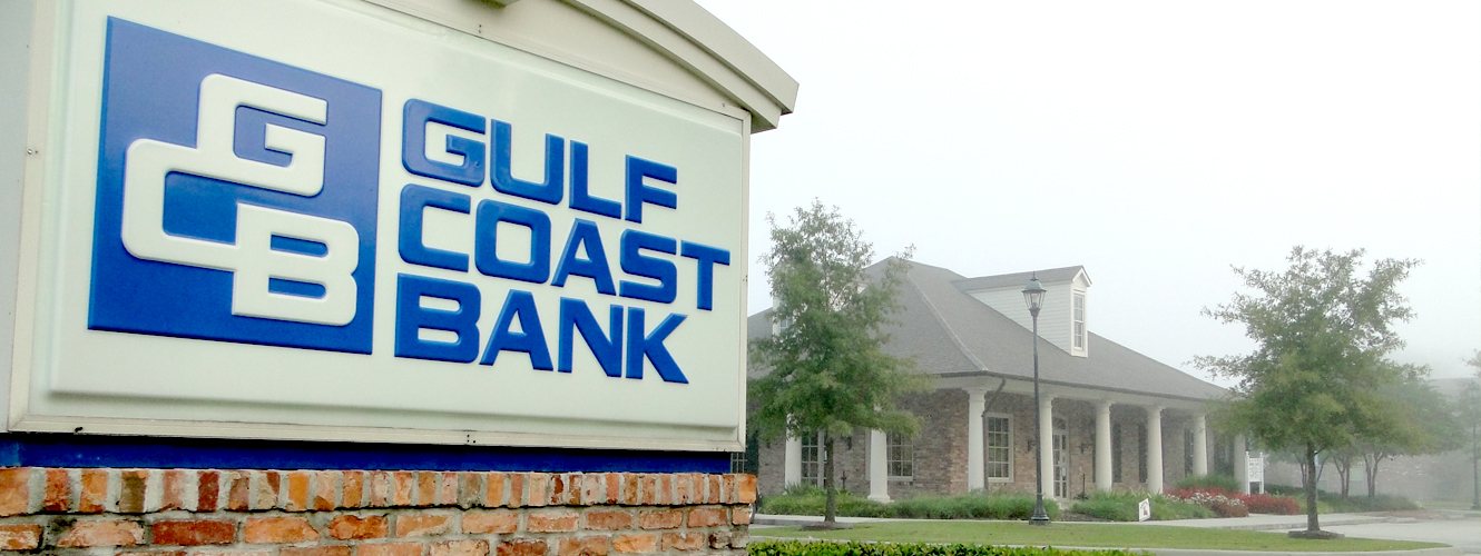 Gulf Coast Bank sign in front of the Ambassador Caffery at Dover branch